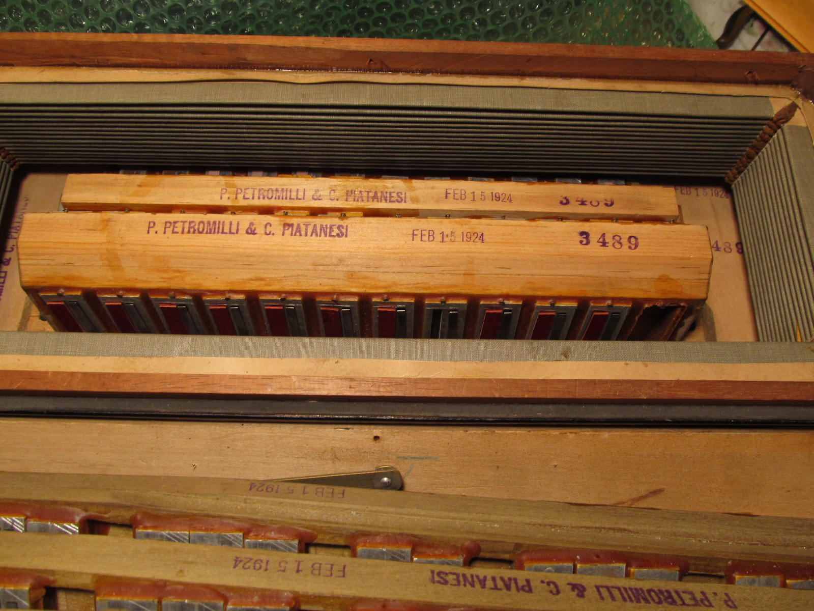 Inside the accordion we see the dates stamped on the treble and bass blocks.
