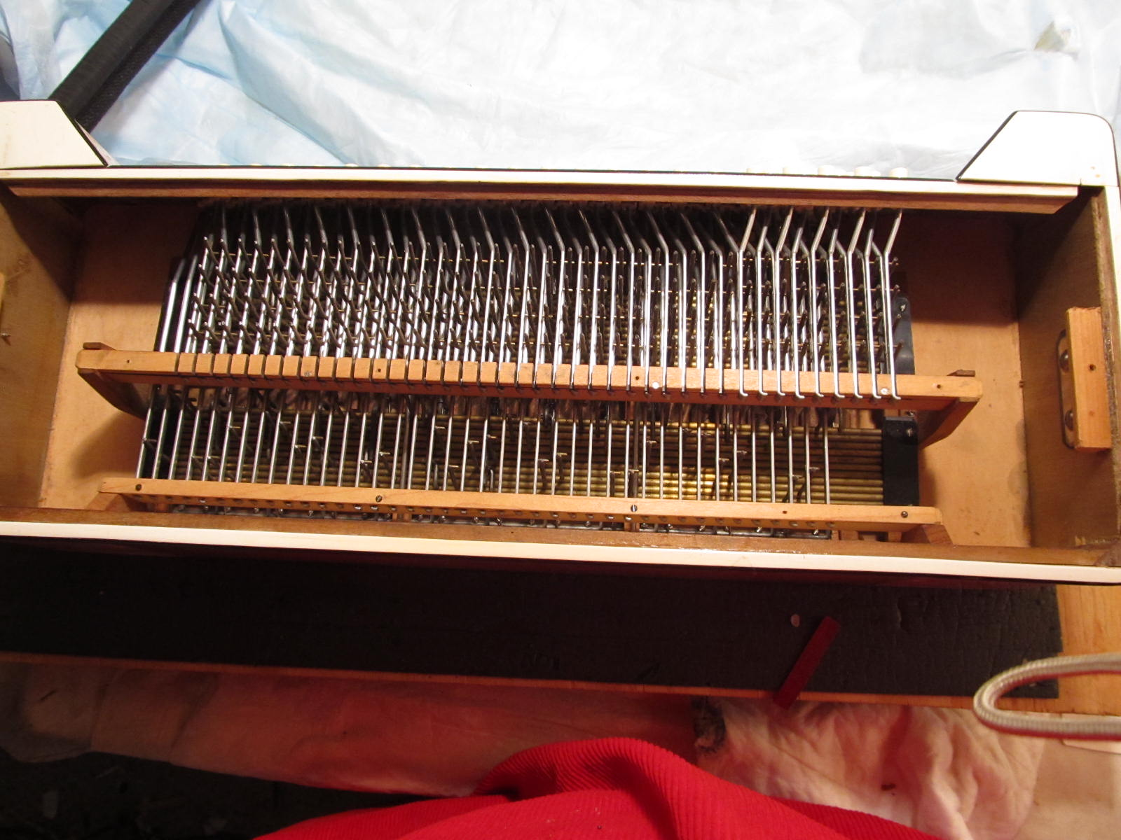 Partially resassembled bass machine in back of antique 1924 Guerrini Accordion
