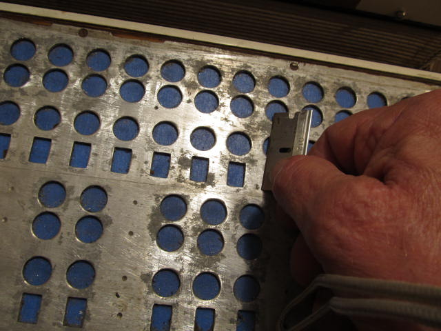 We use a flat blade to scrape any lumps off the treble Valve plate.
