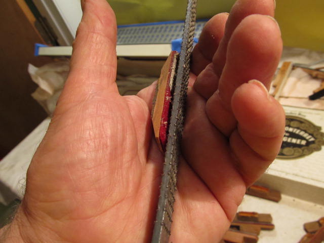 A rasp is a handy tool for removing the old pads.
